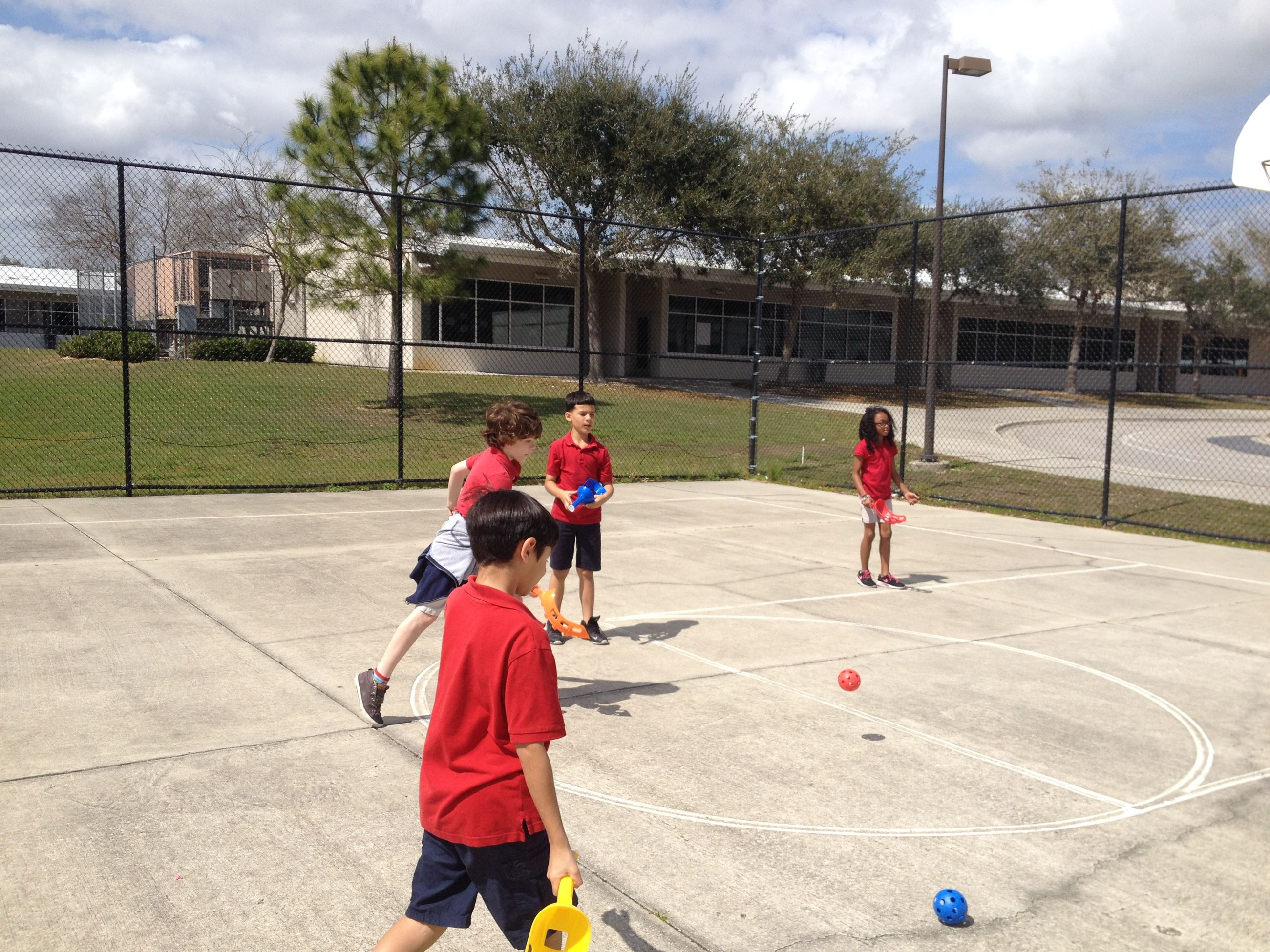 Students playing a catch and release type game for P.E.