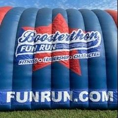 Large red and blue tunnel with Boosterthon logo on the side.